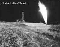 Photo: Okalta well at night, Turner Valley, Alberta. Date unknown (Glenbow Archives NB-16-601)